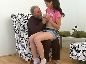 At first she is a little nervous about having sex with this old guy, but once she feels his more experienced touch she's more than happy to let h
