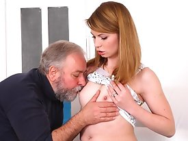 Sveta kneels to get her older mans cum all over her chest and mouth. She has been fucked in many different ways by her older lover as she is his young