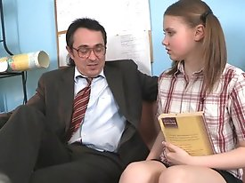 Wow! What a big sausage the teacher has, cute teen girl could hardly gulp it but how great it felt in the pussy.